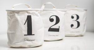 three white bags with numbers