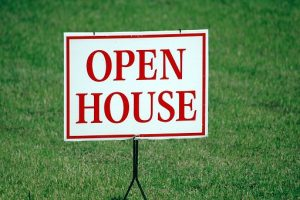 a white and red open house sign set before the move to New York