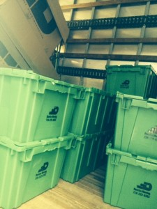 green stackable plastic moving bins