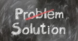 A blackboard with the words PROBLEM and SOLUTION written on it.