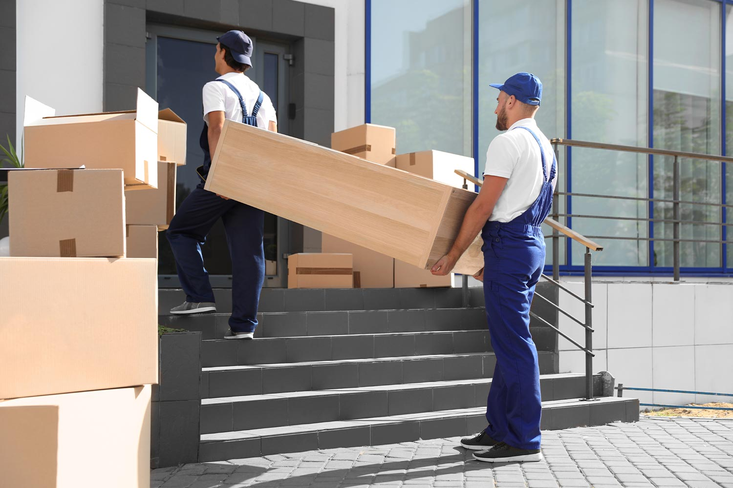 Professional Movers Carrying Heavy Furniture