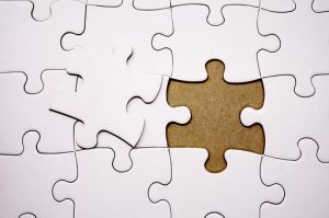 a white puzzle with one missing piece