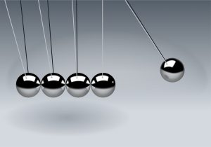 Newton's cradle balls indicating reaction to a NYC move