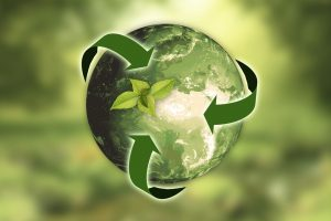 Earth model with sustainability arrows