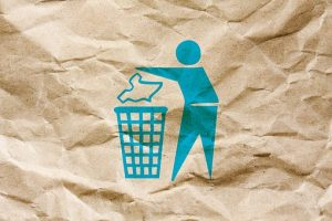A picture of a man throwing cardboad boxes leftovers into recycling bin designed on a crumpled paper