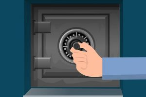 a hand opening a safe before moving valuables