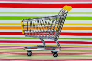 shopping cart and a colorful background