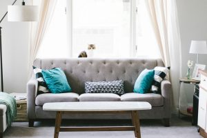 grey sofa with colorful cushions