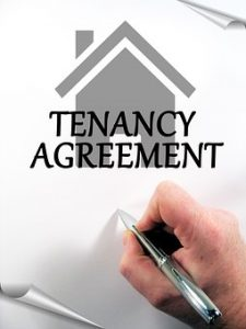 a tenant signing a tenancy agreement