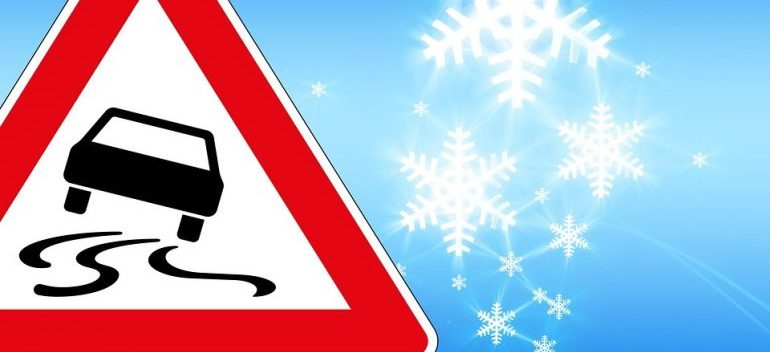 traffic sign indicating ice when moving in winter