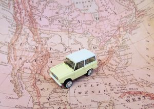 map of the US and a toy car on it