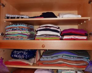 a wardrobe with clothes