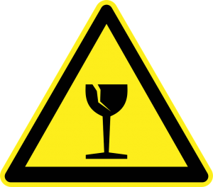A warning sign when packing - yellow triangle with a broken glass in it