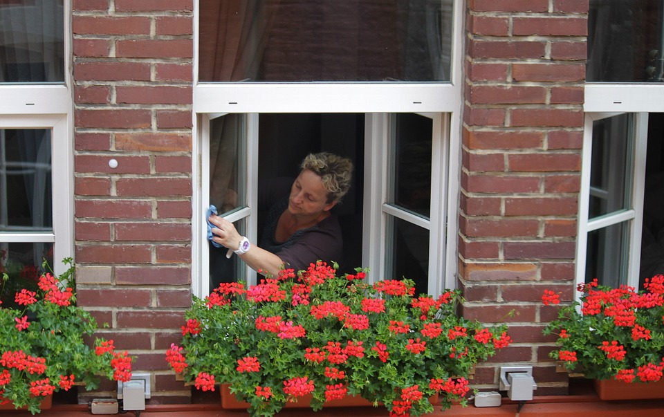 a woman washing windows