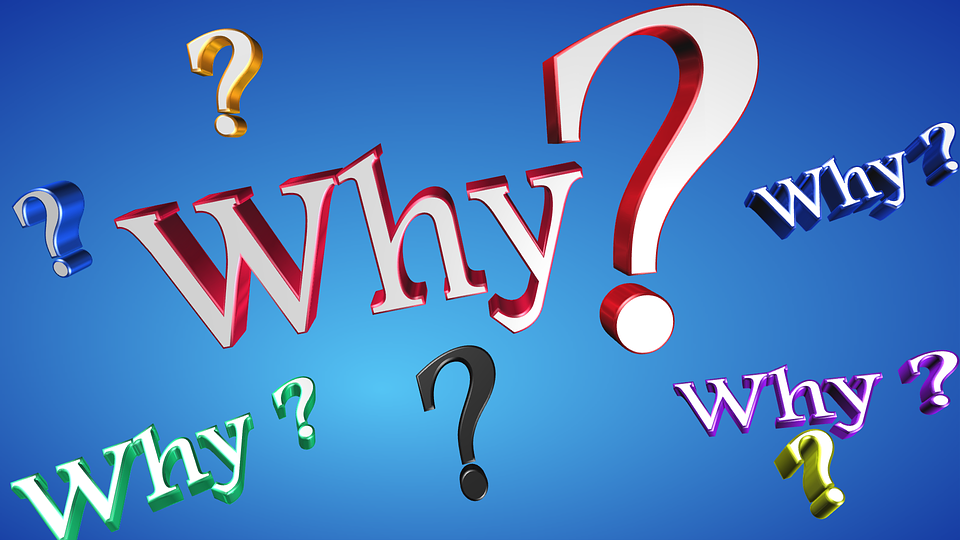 many colorful whys and question marks on a blue background
